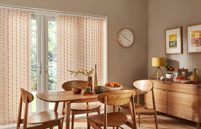 A view of a dining room with beautiful vertical blinds